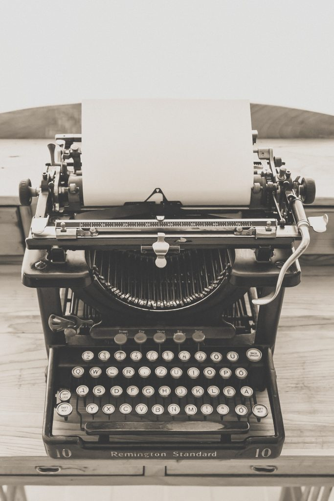 Typewriter showing blank paper